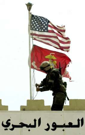 In Umm Qasr, Marines replaces the Iraqi flag at the entrance to Iraq's main port.