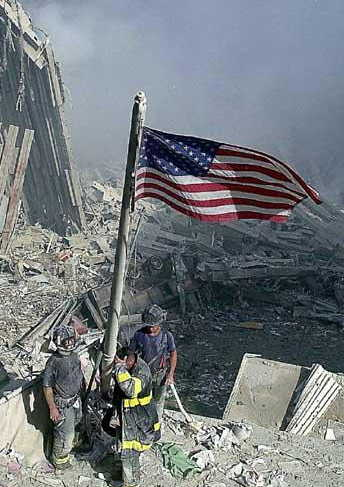 NYFD fighters raising the U.S. flag at the World Trade Center site.